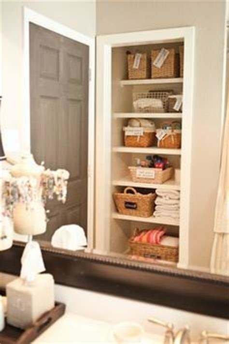 take the door your bathroom linen closet for a chic