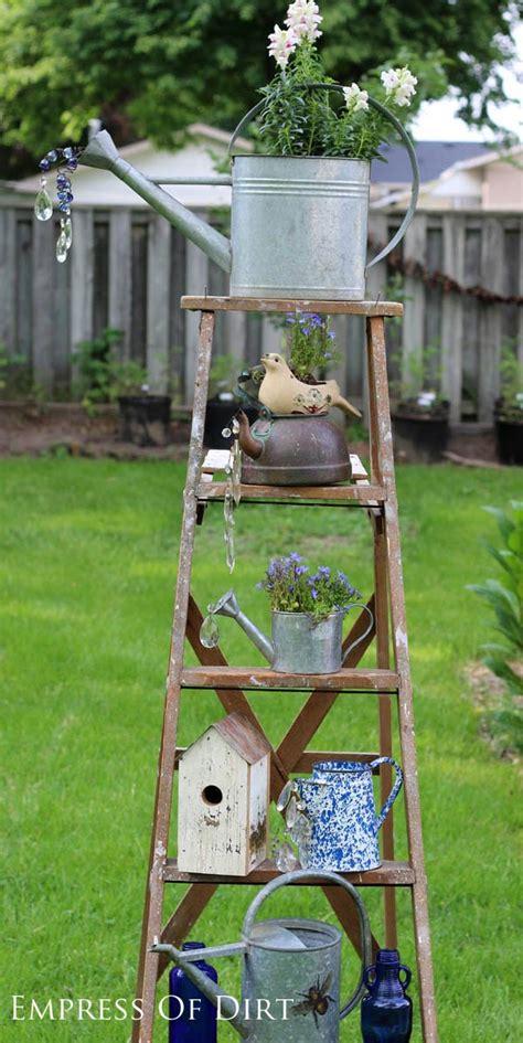 garden in a can watering can garden ideas empress of dirt