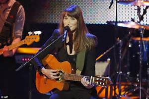 Carla Bruni puts on a brave face during a performance at ...