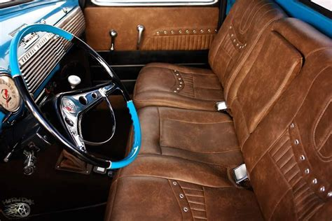 Saddle Leather And Grommet Reupholstered Second Row