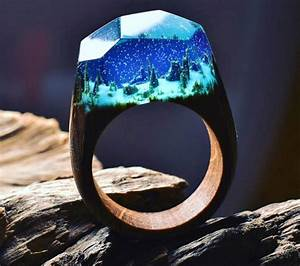 beautiful wooden rings with mini landscapes encapsulated