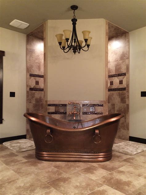 Rustic Spa Bathroom by Rustic Bathroom Hammered Copper Tub In Front Of A Corner