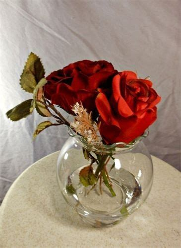 hand  double red rose centerpiece  maryseverflowers