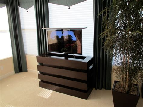 le bloc tv lift cabinet in bedroom tv lift cabinets by cabinet tronix le bloc tv lift cabinet in a beautiful modern bedroom