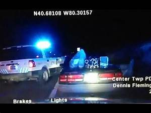 US woman steals police car while handcuffed - YouTube