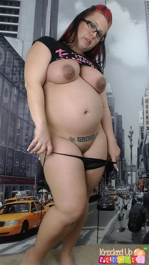 Pregnant Hot Redhead Peaches Revealing Her Huge Belly And