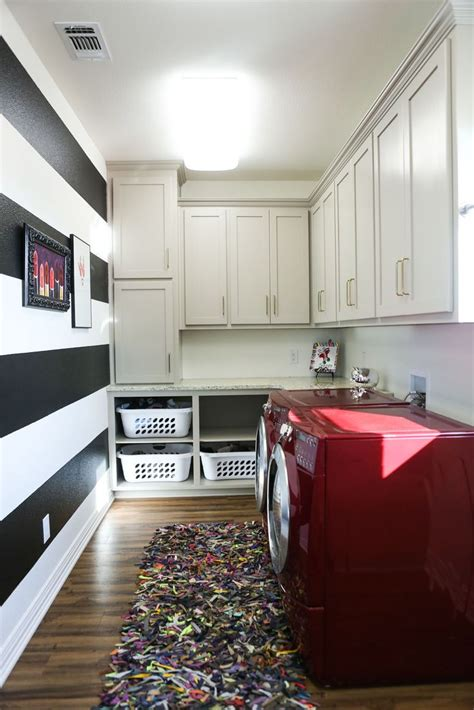 laundry room  black  white stripes wall red washer