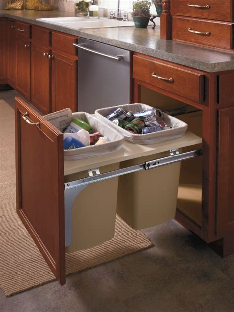 aristokraft s double wastebasket cabinet keeps trash