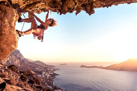 Upside Down Climbers Cling Onto Rock Edge Gorgeous