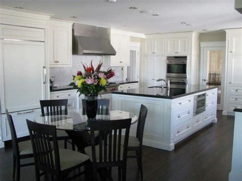kitchen dark floors white cabinets  black