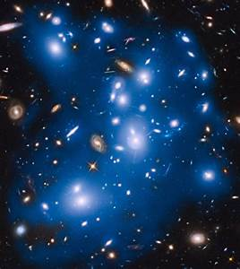 Hubble Views Ghostly Glow of Stars Ejected from Dead Galaxies