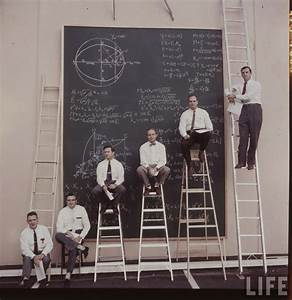 NASA scientists with their board of calculations, 1961