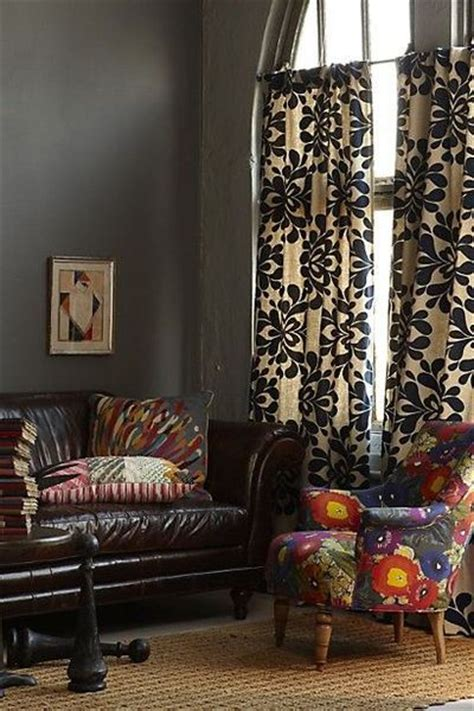 curtains with gray walls and brown leather for the