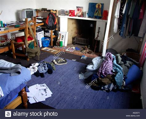 Messy Piles Of Clothes In Teenage Boy's Bedroom Stock