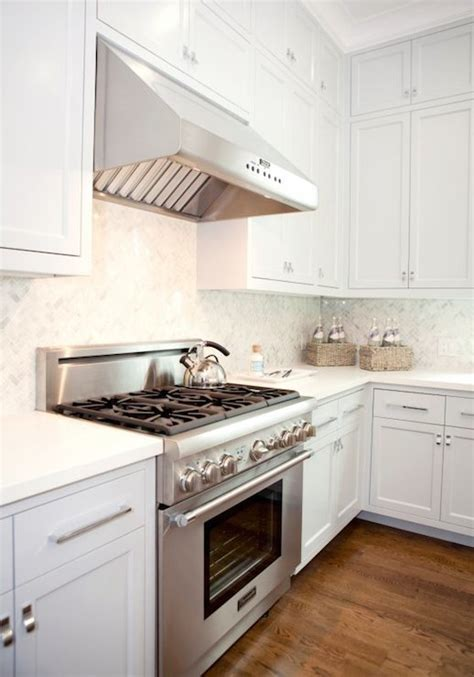 White Kitchen with Gray Wash Wood Tile Floors