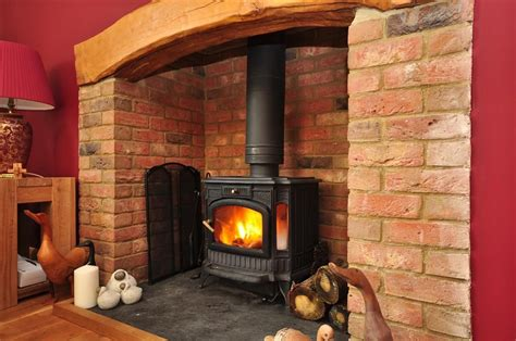 fireplaces for wood burners ideas photo of rustic warm brick with bare floorboards