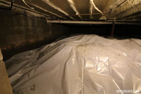 covering basement crawl space floor with plastic vapor barrier covering basement crawl space floor with plastic vapor barrier