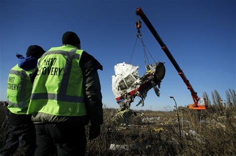 Malaysia airlines flight 17 (mh17) was a scheduled passenger flight from amsterdam to kuala lumpur that was shot down on 17 july 2014 while flying over eastern ukraine. Dutch team at MH17 crash site recovers more remains