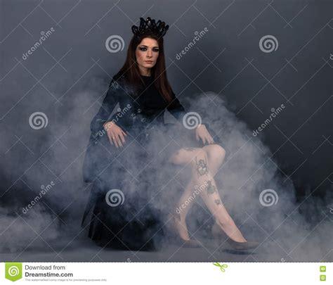 bug queen woman  crown wearing black dress  dress