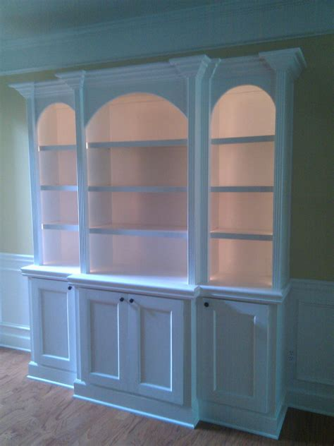 custom built  bookcases  arched tops fluted column