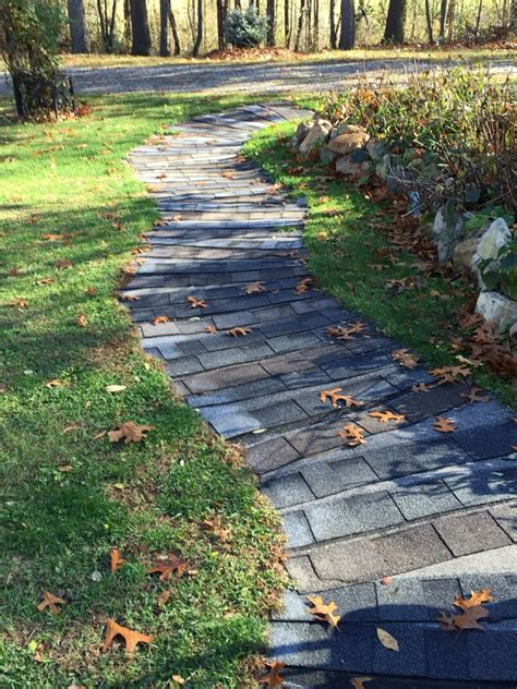 Repurposed asphalt shingles into a garden path or 'deck