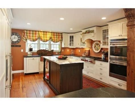 Kitchen Paint Color Pumpkin by Kitchen With Ivory Cabinets And Burnt Orange Pumpkin