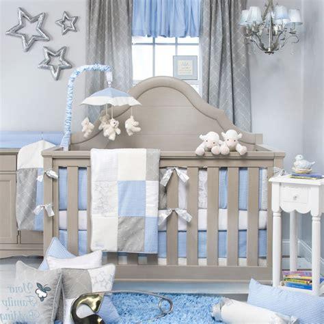 baby blue and grey nursery room with grey crib