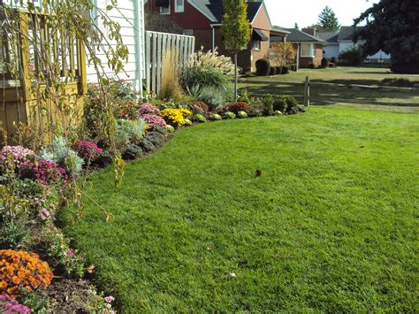 yard pictures side yard landscaping house design with various garden flowers and green grass with recycled
