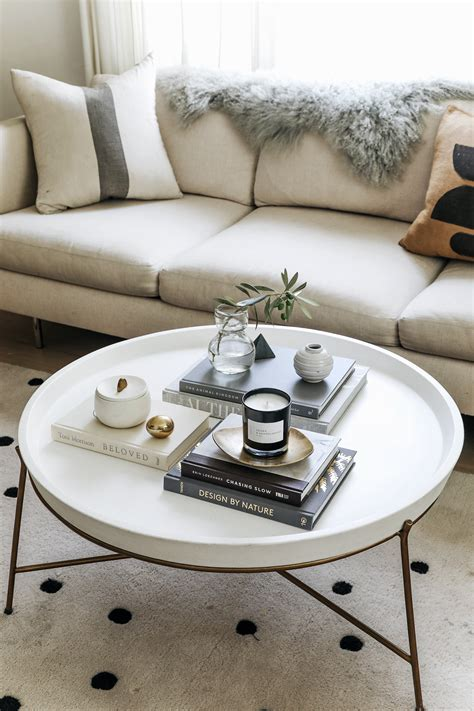 #coffeetable this coffee table has the right ingredients for styling….fresh flowers, lovely books, a tray to corral, colored glass, a gilded bowl, and a pretty box. Coffee Table Styling Tips for Round Coffee Tables - Anne Sage