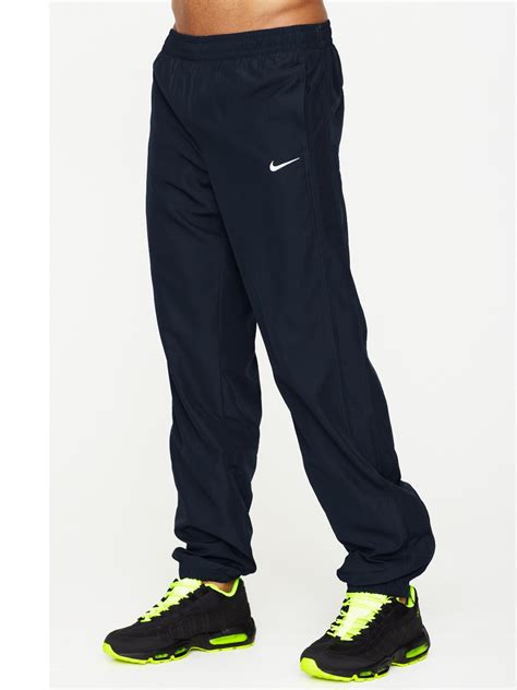 cuffed sweatpants for nike woven cuffed track in black for lyst
