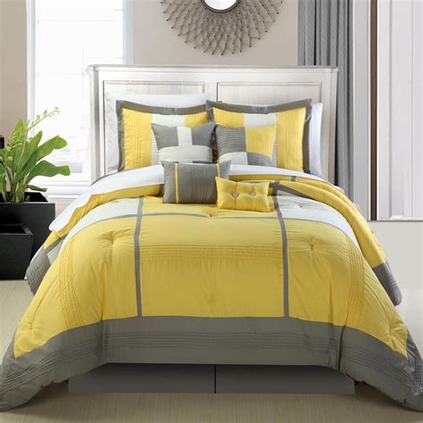minimalist bedroom with yellow grey embroidery comforter