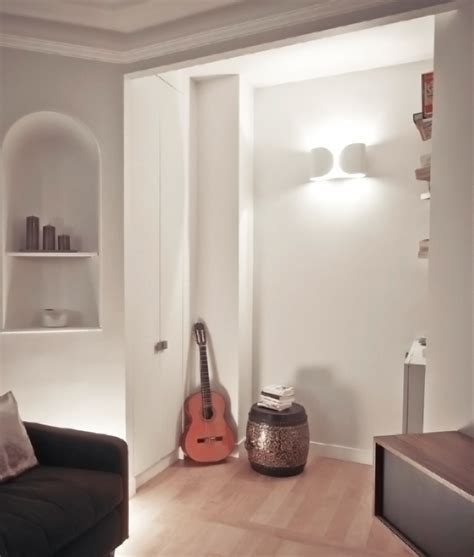 decorative fluorescent light foglio wall light by flos available in three finishes