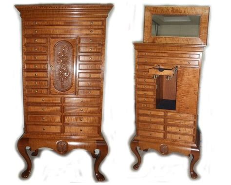 hand  jewelry armoire  wood  reflections