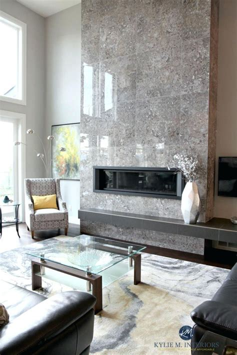 contemporary design living room tall tile fireplace modern