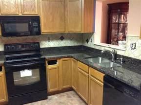 granite countertops ideas kitchen donna s brown granite kitchen countertop w travertine backsplash granix