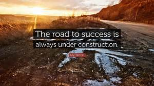 Lily Tomlin Quote The Road To Success Is Always Under