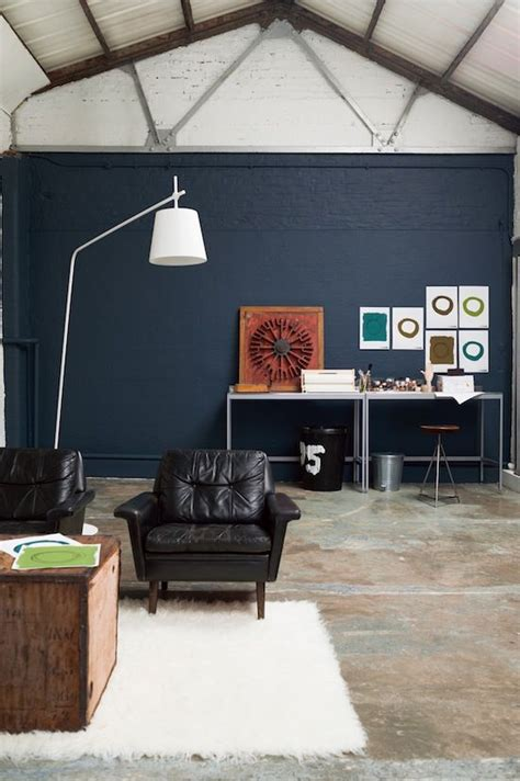 cool warehouse living room painted  indigo night