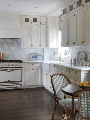 white kitchen cabinets  brass hardware transitional