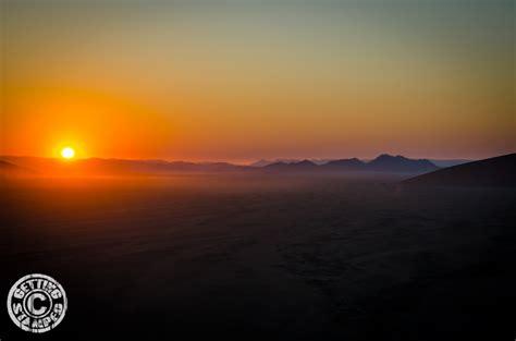 sunrise sand dunes namibia stamped