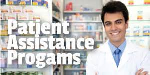Pharmacist standing in front of the pharmacy with prescriptions.