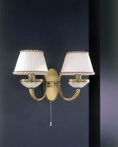 2 light brass and frosted glass wall sconce with l