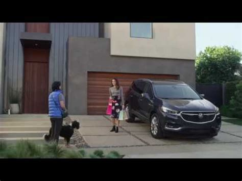 dog walker   buick enclave commercial courtesy