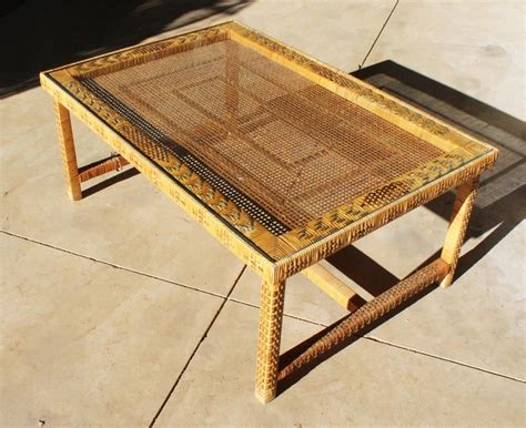 Woven fiber exterior with brushed metal pulls. 1970s Spanish Woven Wicker Wooden Coffee Table For Sale at 1stDibs