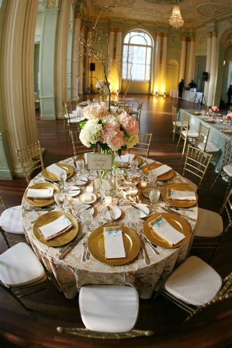 wedding reception tablescape  gold charges hydrangeas