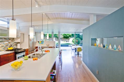pendant track lighting kitchen midcentury with accent wall