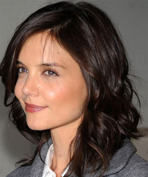 katie holmes casual long wavy hairstyle  side swept bangs