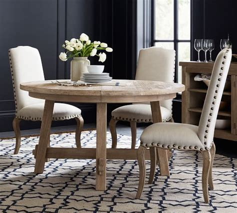 Two breadboard leaves drop in seamlessly at either end, making the table ideal for large gatherings. Toscana Round Extending Dining Table - Seadrift | Pottery Barn