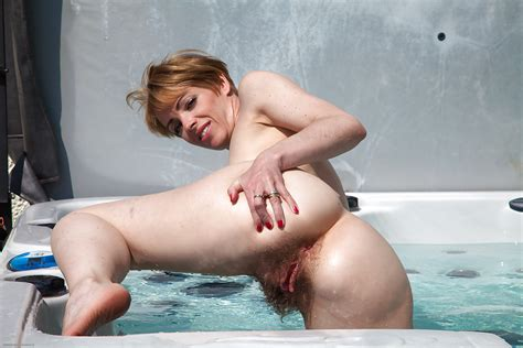 Amateur Mature Shows Off Her Hairy Pussy In The Doggystyle