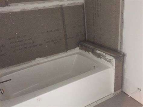 photo guest bath tub  ledge  shelving