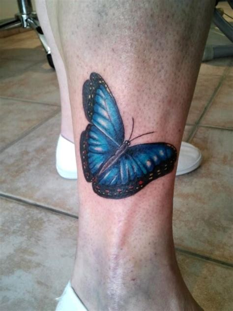 tatouage papillon bleu inkage
